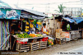 This colorful fruit stand was located along the road in Cavite. Cavite, Philippines 'Minolta X-700 35mm SLR' (Click for larger view)