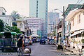 This typical view of what a street in Manila looks like. The jeepneys parked along the left side of the street are a main part of the transportation system in Manila. Manila, Philippines 'Minolta X-700 35mm SLR' (Click for larger view)