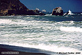 In the second Pacifica picture, waves break over the rocks as the tide comes in. Pacifica, CA. 'Nikon F100 35mm SLR' (Click for larger view)
