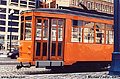 This picture of an orange trolley car was taken out the window of my car at one of the many stop we made while inching our way along the Embarcadero. San Francisco, CA. 'Minolta X700 35mm SLR' (Click for larger view)