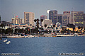 I arrived at the harbor just in time to see the moon peeking from behind the San Diego skyline. San Diego, CA 'Minolta X700 35mm SLR' (Click for larger view)