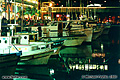 This photo of some of the boats along Fisherman's Wharf was taken at night. San Francisco, CA. 'Nikon F100 35mm SLR' (Click for larger view)